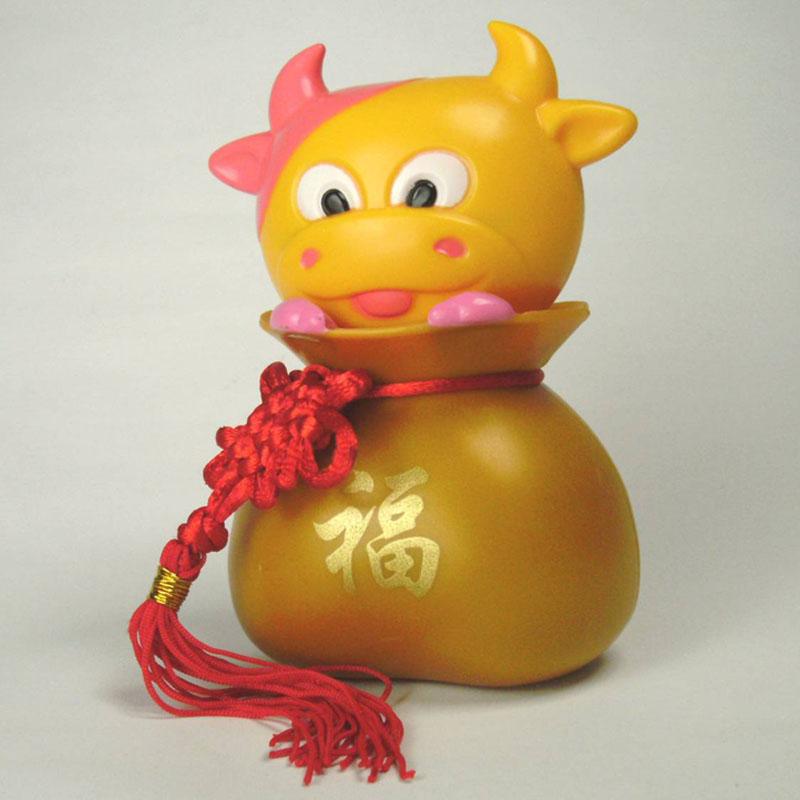 钱袋系列(黄金牛)底座黄色--招财纳福太阳能摇头公仔